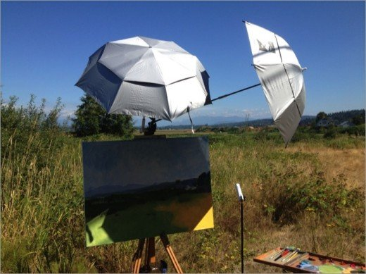 "My setup for the painting ""Lowell Larimer Road II."" Obviously I need a couple more umbrellas."